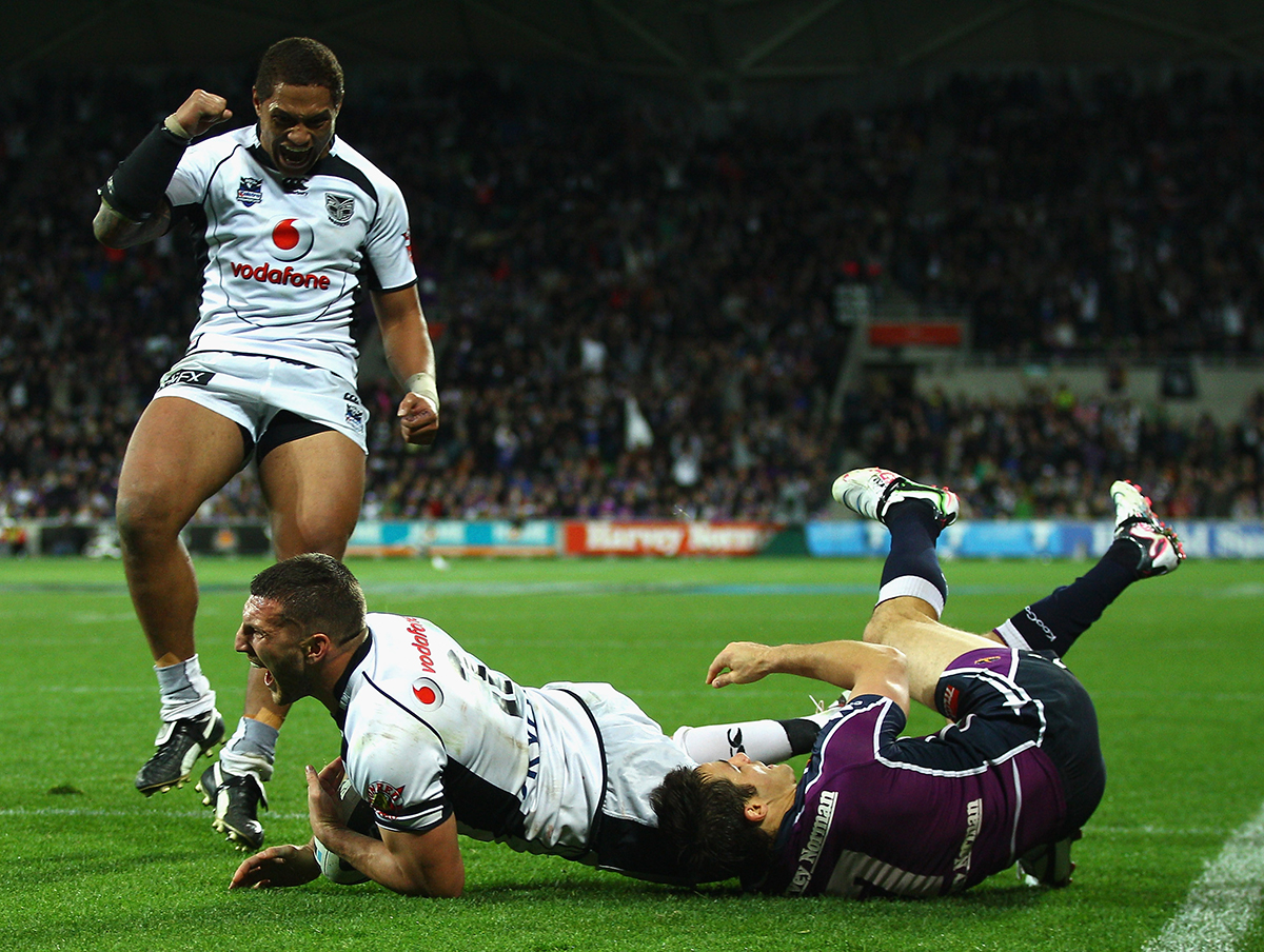 10. Lewis Brown of the Warriors celebrates a try with Manu Vatuvei during the NRL second preliminary final match between the Melbourne Storm and the New Zealand Warriors at AAMI Park in Melbourne