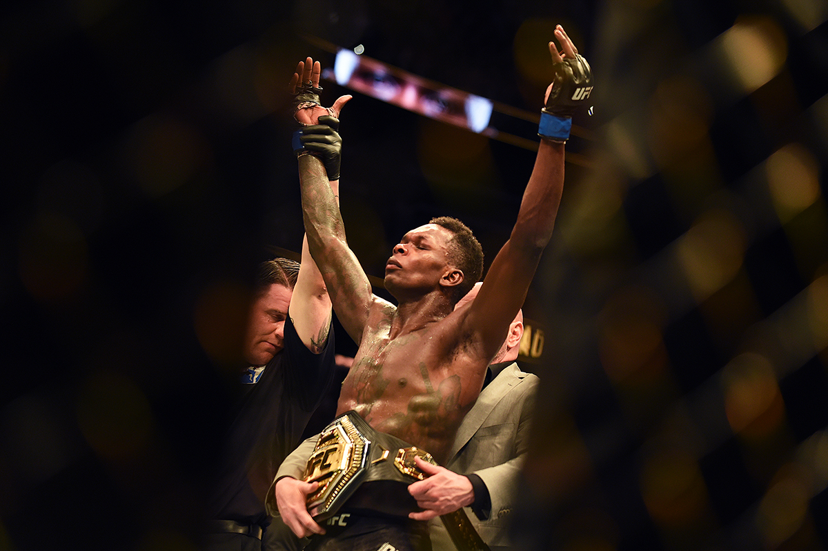 14. Israel Adesanya celebrates after winning the title by defeating Kelvin Gastelum during the UFC 236 event at State Farm Arena on April 13 2019 in Atlanta Georgia