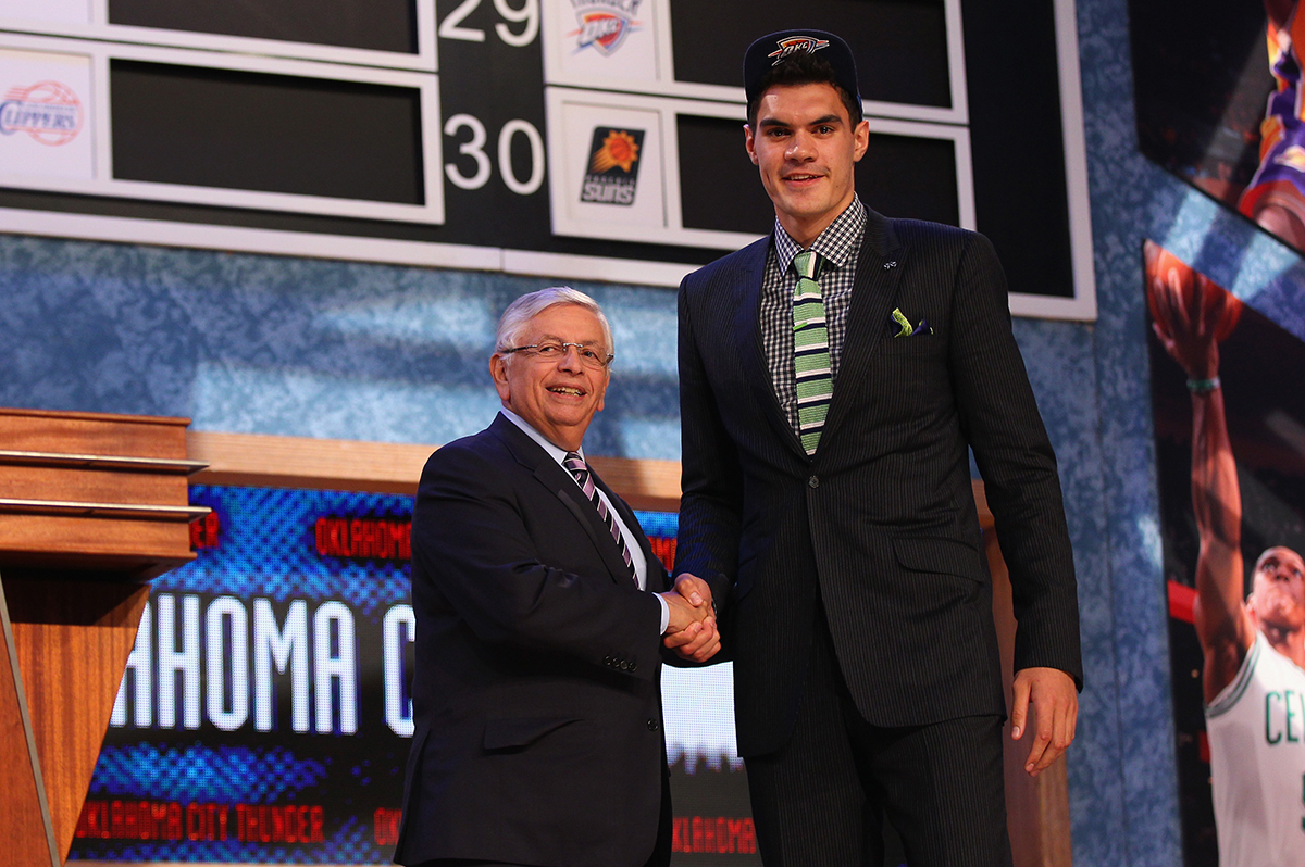 4. Steven Adams poses for a photo with NBA Commissioner David Stern after Adams was drafted 12 overall in the first round by the Oklahoma City Thunder during the 2013 NBA Draft at Barclays Center on June 27 2013