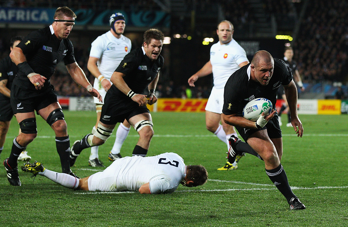 7. Tony Woodcock of the All Blacks breaks clear on the way to scoring his try during the 2011 IRB Rugby World Cup Final match between France and New Zealand at Eden Park on October 23 2011